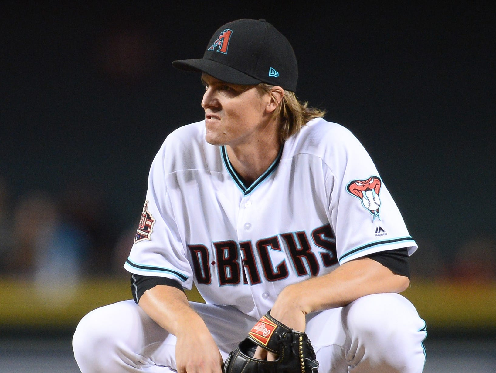 Sep 21, 2018; Phoenix, AZ, USA; Arizona Diamondbacks starting pitcher Zack Greinke (21) reacts against the Colorado Rockies during the fifth inning at Chase Field.