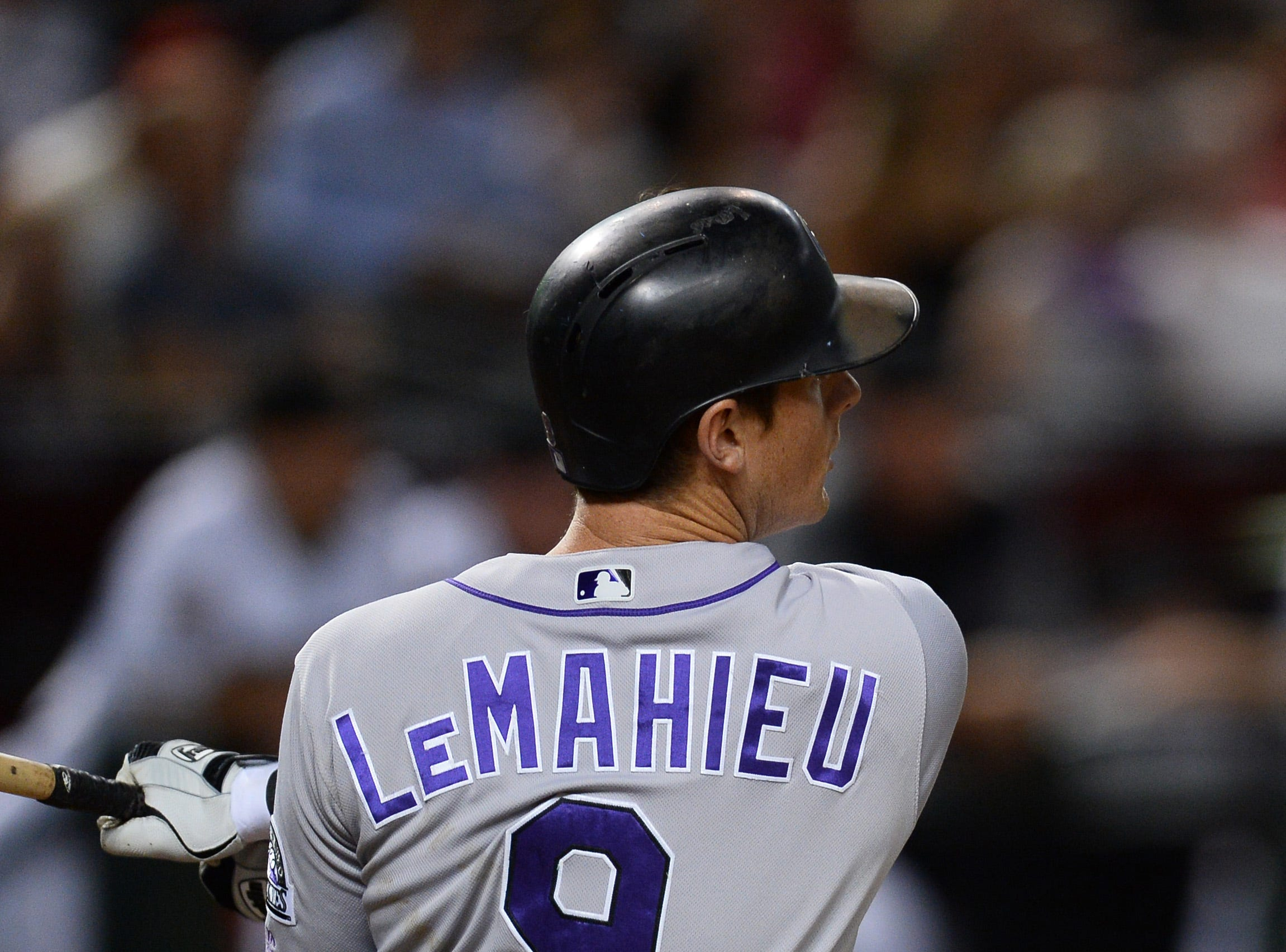 Sep 21, 2018; Phoenix, AZ, USA; Colorado Rockies second baseman DJ LeMahieu (9) hits an RBI single against the Arizona Diamondbacks during the sixth inning at Chase Field.