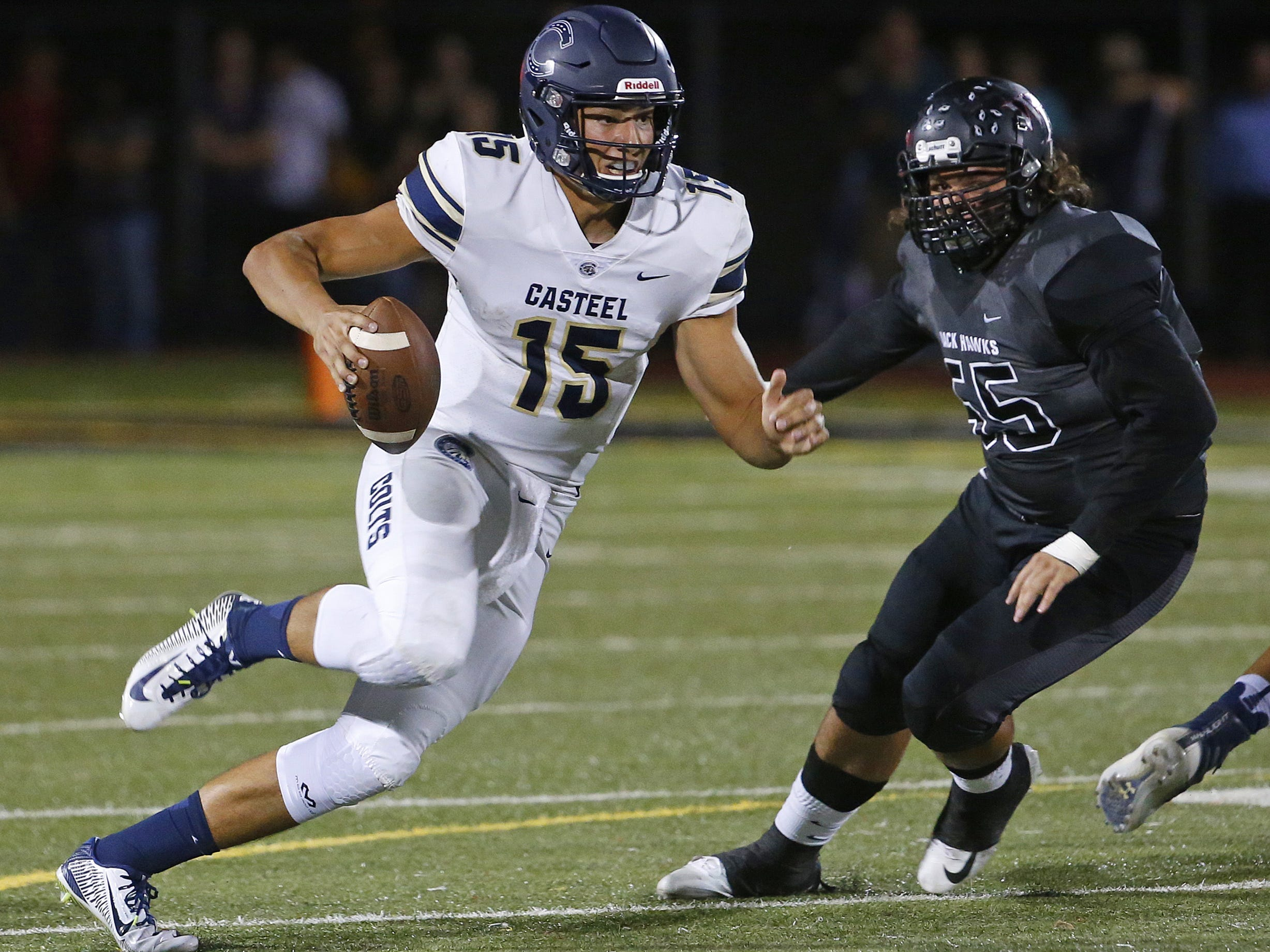 Casteel's Gunner Cruz (15) scrambles away from Williams Fields Nathaniel Rebollosa (55) at Williams Field High School in Gilbert, Ariz. on Sept. 21, 2018.  #azhsfb