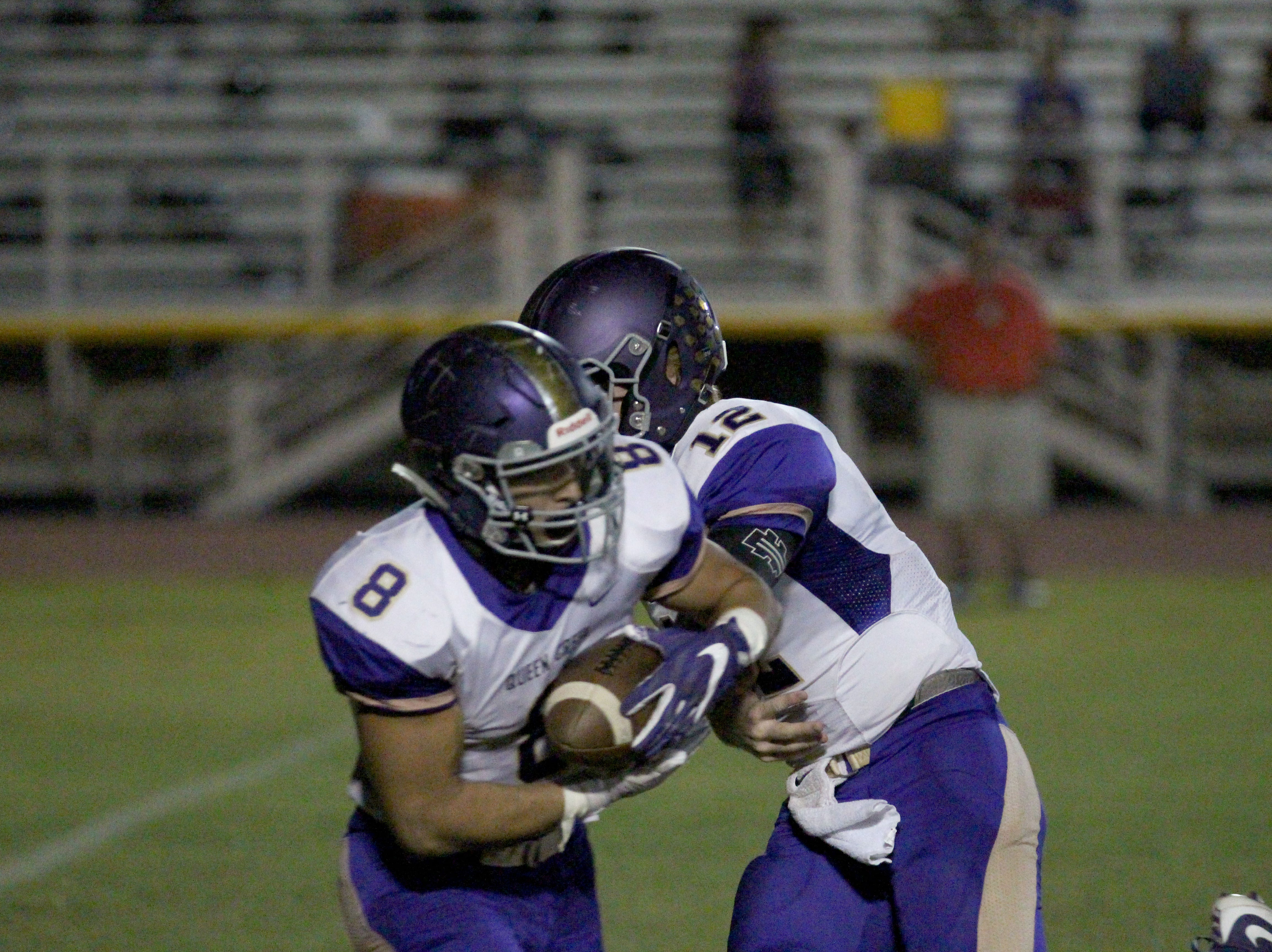 Queen Creek's Dylan Borja takes the handoff during the game against Mountain Pointe on Friday night at Mountain Pointe High School on Sept. 21, 2018.