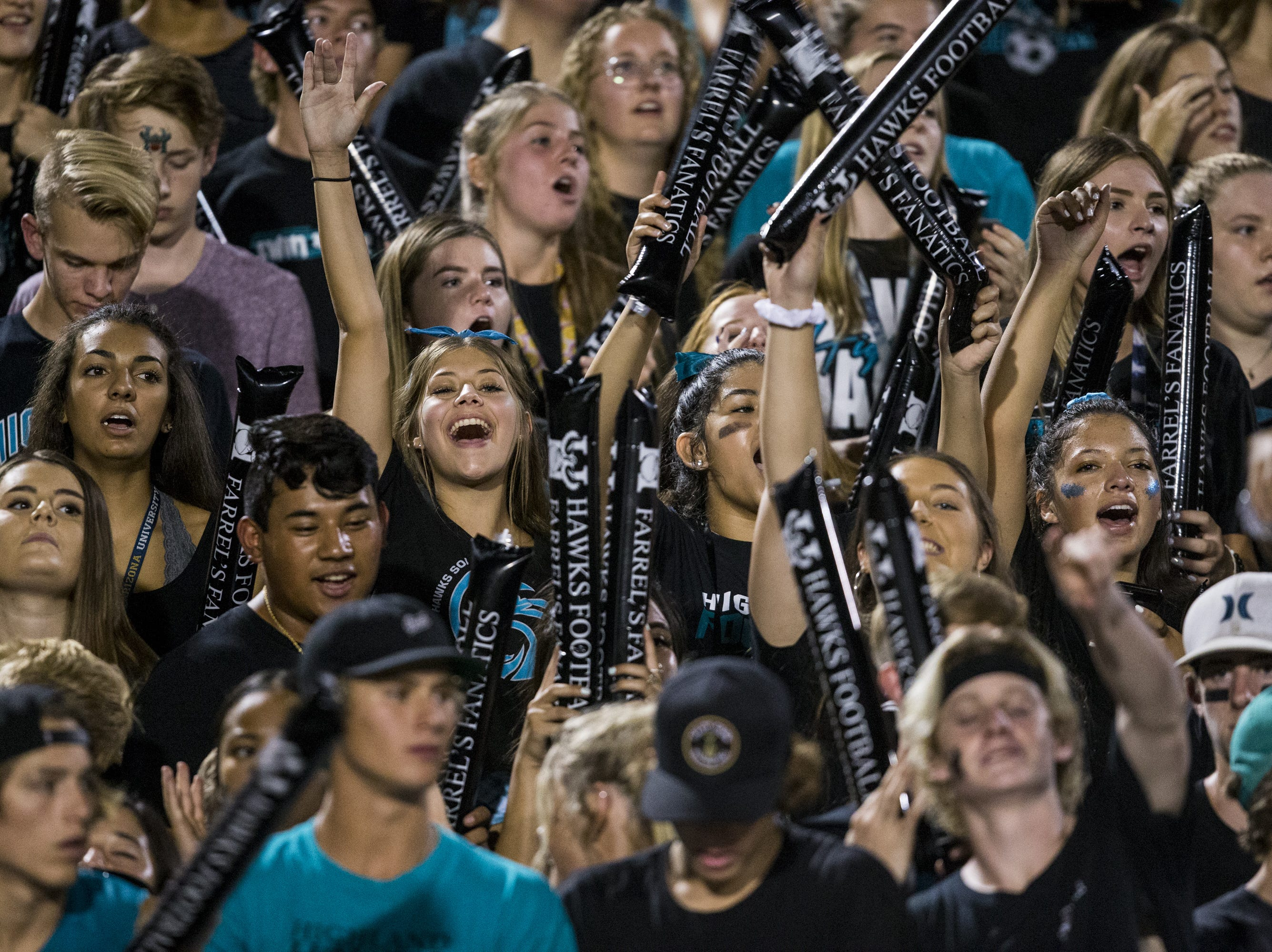 Highland fans cheer during the game against Desert Vista on Friday, Sept. 21, 2018, at Highland High School in Gilbert, Ariz.