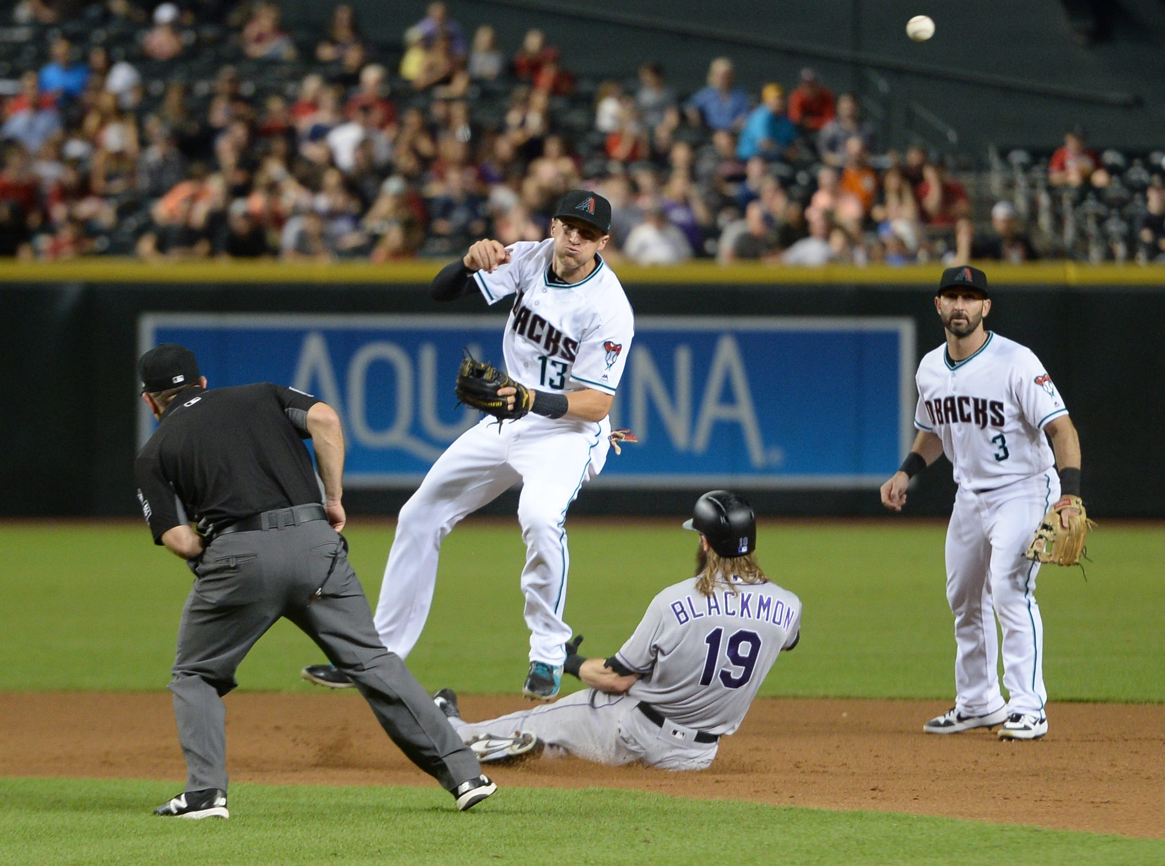 Sep 21, 2018; Phoenix, AZ, USA; Colorado Rockies center fielder Charlie Blackmon (19) attempts to break up a double play attempt by Arizona Diamondbacks shortstop Nick Ahmed (13) during the eighth inning at Chase Field.