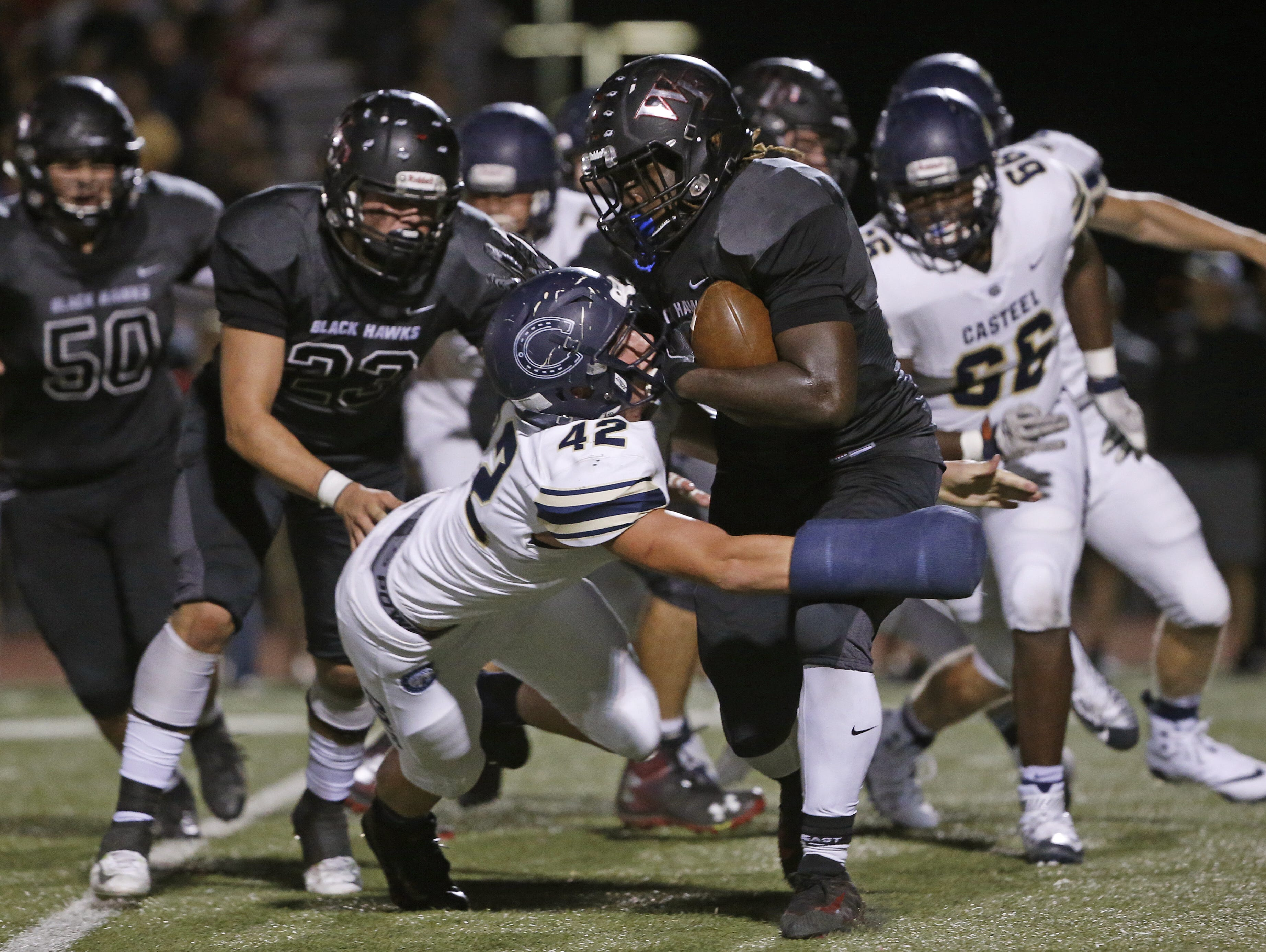 Casteel's Cruz Webster (42) tackles Williams Field's Jaden Thompson (25) at Williams Field High School in Gilbert, Ariz. on Sept. 21, 2018.  #azhsfb
