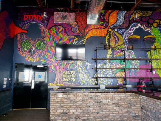 The murals at State 48 Brewery in downtown Phoenix are all by local artist Leila Parnian, and the bar shelves are made from salvaged old pipe from the building.
