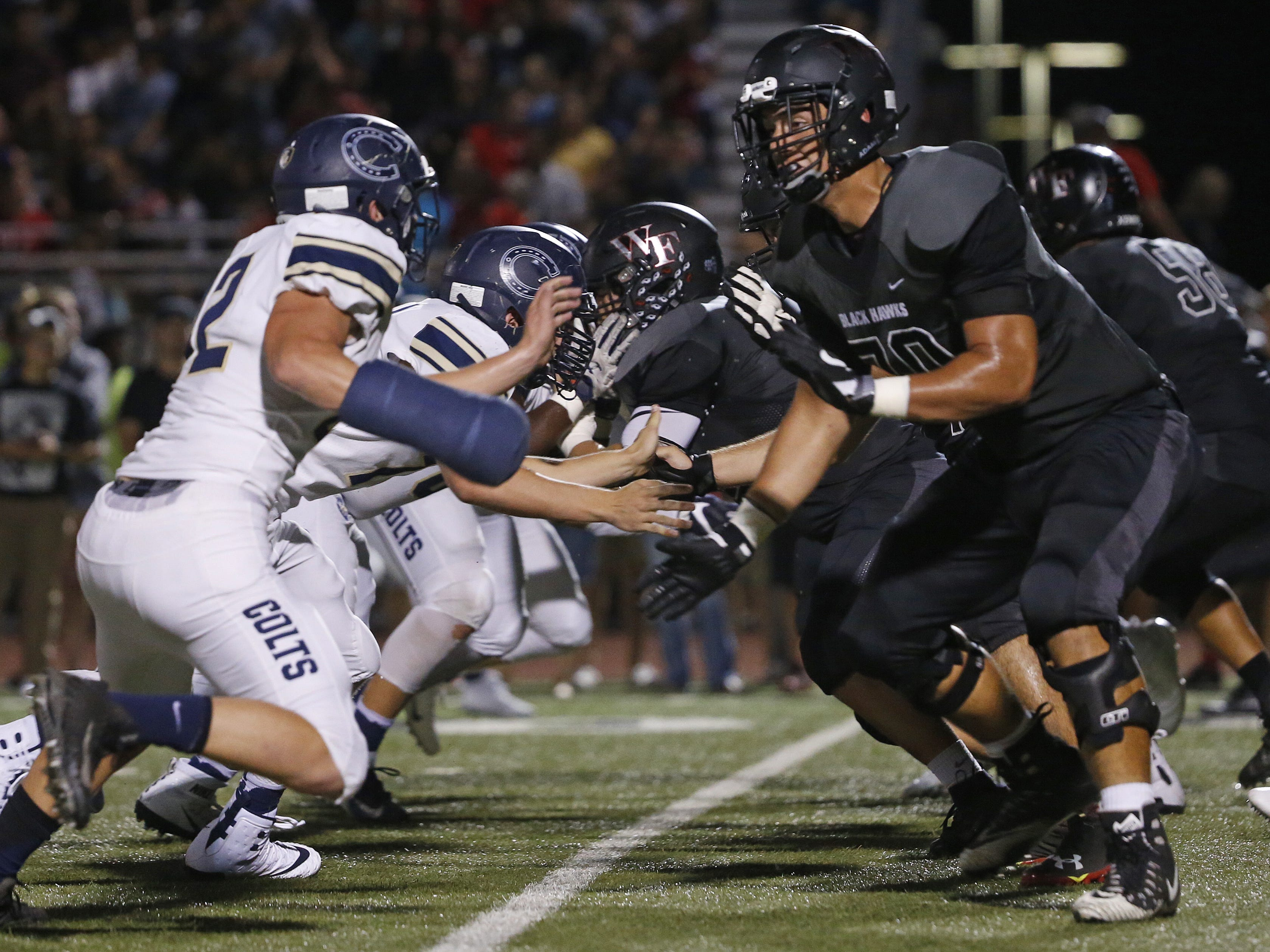 Williams Field's Noah Nelson (70) blocks Casteel's Cruz Webster (42) at Williams Field High School in Gilbert, Ariz. on Sept. 21, 2018.  #azhsfb