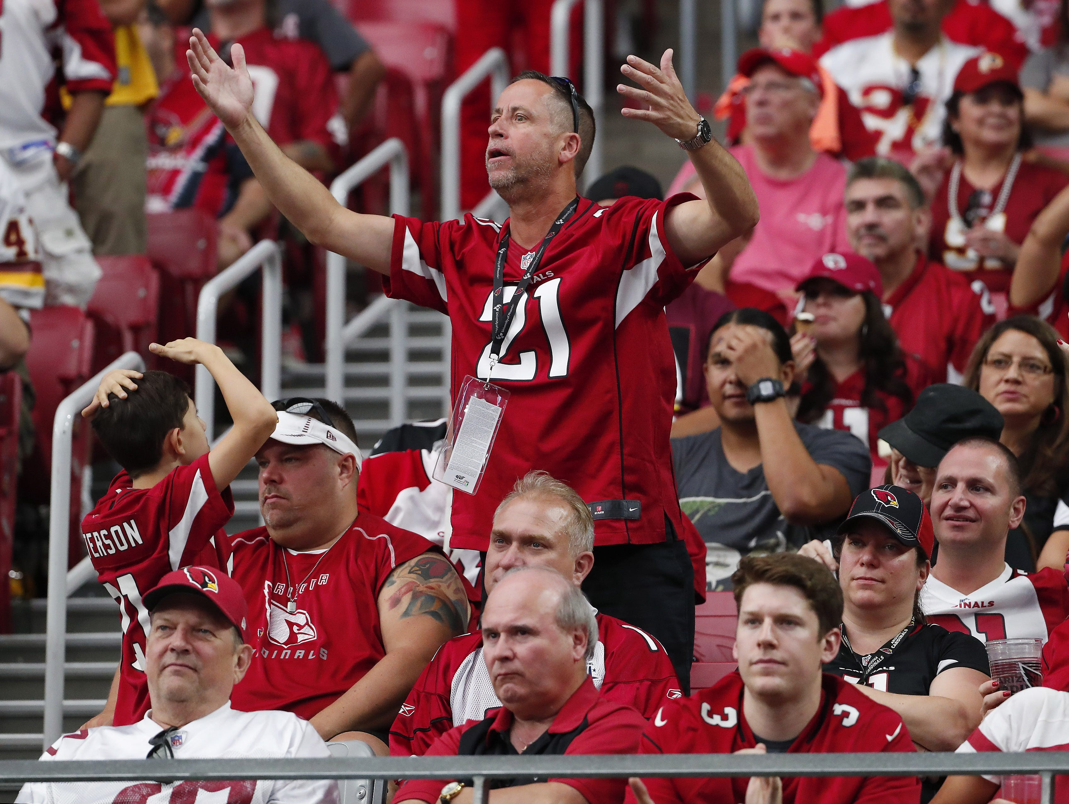 An Arizona Cardinals fan argues for a call against the Washington Redskins during the third quarter at State Farm Stadium in Glendale, Ariz. September 9. 2018.