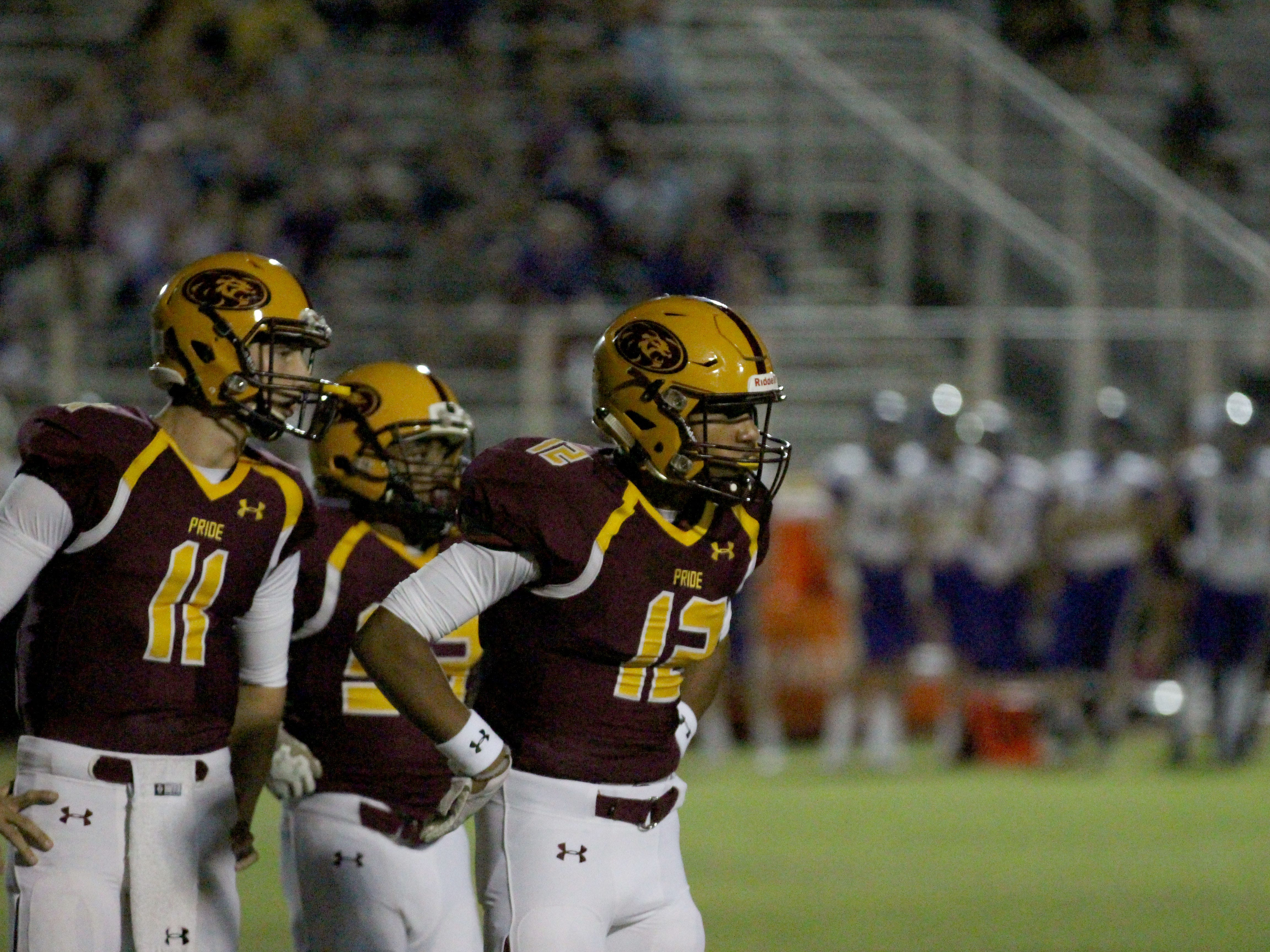 Mountain Pointe players look to sideline in game against Queen Creek on Friday night at Mountain Pointe High School on Sept. 21, 2018.