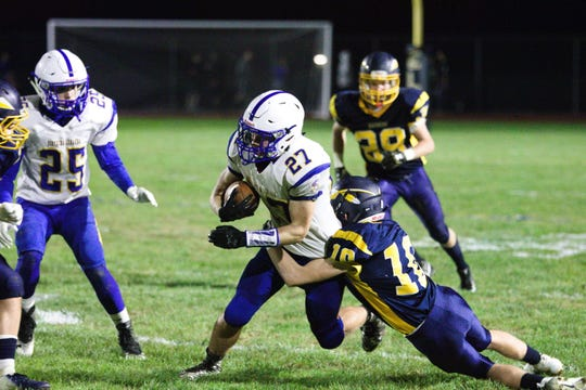 Northern Lebanon wide receiver Nate Leedy-Reidel fights for extra yardage in a game against Elco last year.