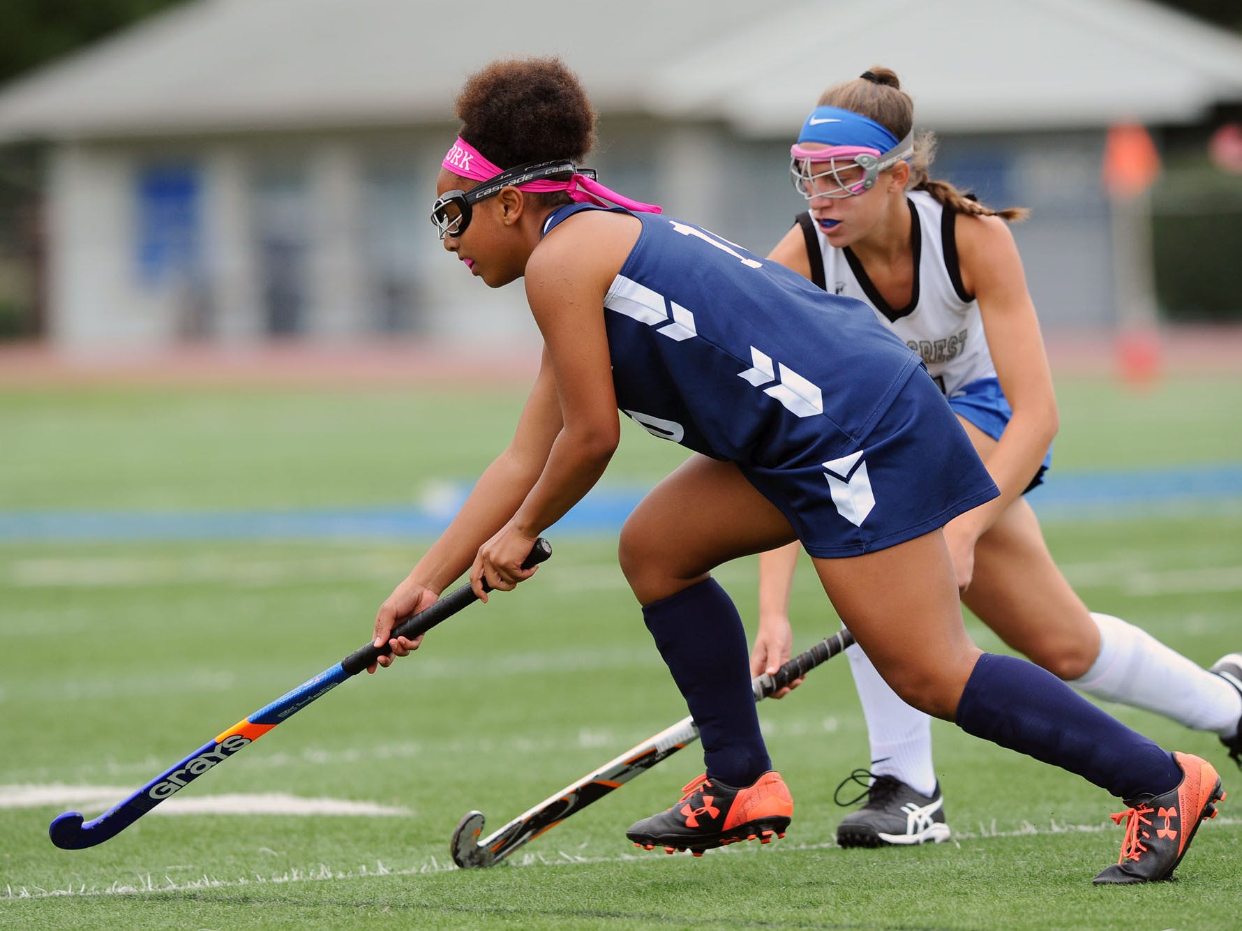 Neveah Green (10) from West York tries to move the ball down field past Regan Vukovich (4) from Cedar Crest during play in the final game of the Falcon Fall Classic at Cedar Crest High School Saturday, September 22,2018.