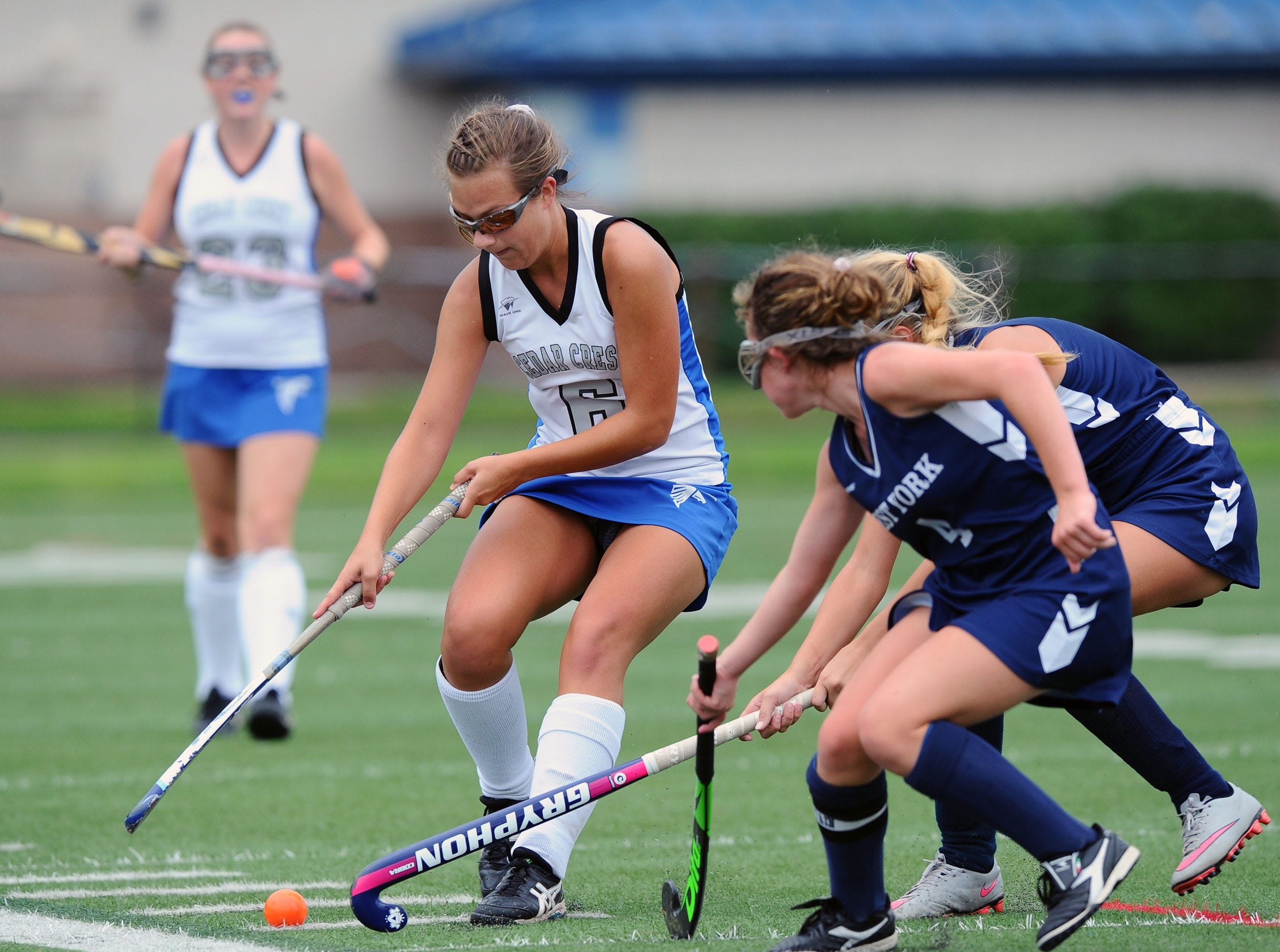 Molly Bucher (6) of Cedar Crest tries to move past two West York defenders during play in the final game of the Falcon Fall Classic at Cedar Crest High School Saturday, September 22,2018. Photo Jeff Ruppenthal.