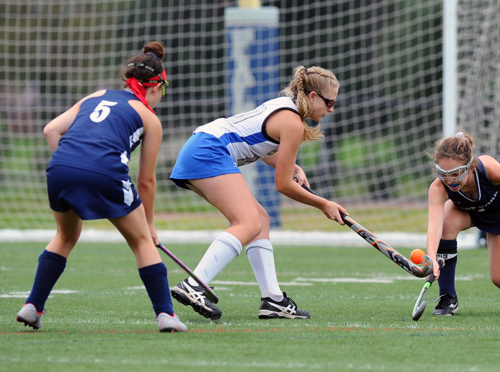 Cedar Crest's Hanna Lewis(10) tries to get control of the ball between West York's Nikki Jumba (5) and Maggie Spadafora (4) during play in the finals of the Falcon Fall Classic at Cedar Crest High School Saturday, September 22, 2018.