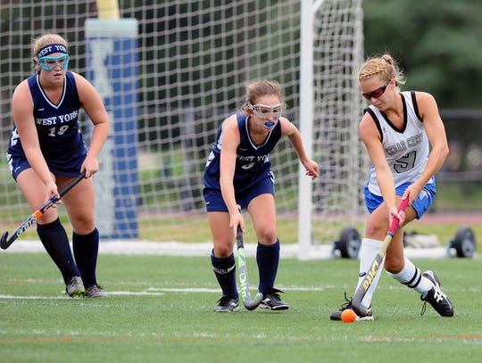 Emma Holzman (9) from Cedar Crest tries to move the ball around two West York defenders during play in the final game of the Falcon Fall Classic at Cedar Crest High School Saturday, September 22, 2018.