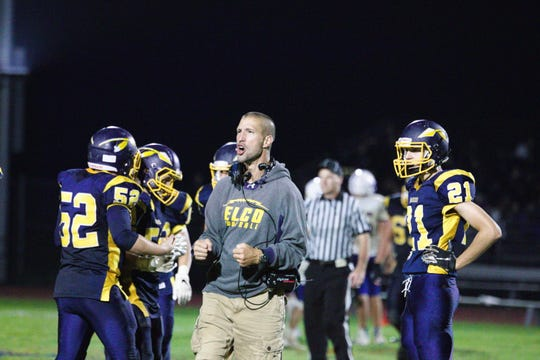 Elco coach Bob Miller shouts encouragement to his team during the Raiders' win over Northern Lebanon last month. Elco has been the surprise of the Lebanon County football season, winning five of its first six games.