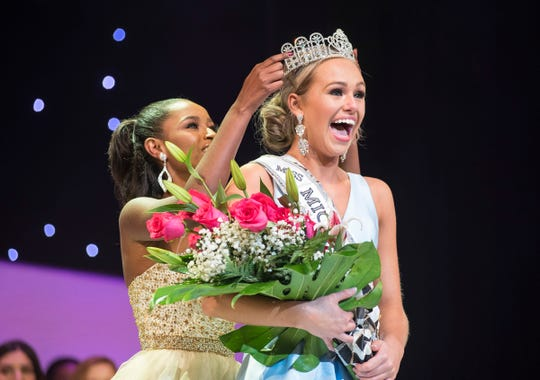 Miss Canton Teen Alexis Lubecki, right, is crowned by 2018 Miss Michigan Teen USA Anane Loveday Saturday, Sept. 22, 2018 during the Miss Michigan Teen USA pageant at McMorran Theater.