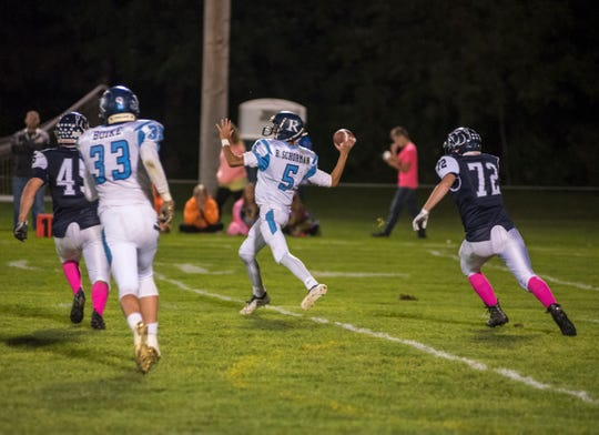 Richmond High School quarterback Brandon Schorman (5) throws an incomplete pass Friday, Sept. 21, 2018, during their game at Yale High School.