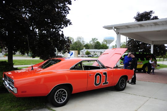 Brian and Colin Sterling of Ira Township admire a version of the General Lee from The Dukes of Hazzard at the International Marine City Comic  Con at the RIvertown Event Centre in Marine City.