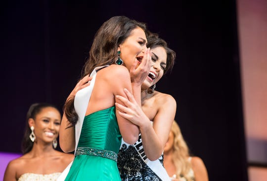Miss Garden City Alyse Madej, right, is hugged by Miss Delhi Victoria Davis after being named Miss Michigan USA Saturday, Sept. 22, 2018 at the Miss Michigan USA pageant at McMorran Theater.