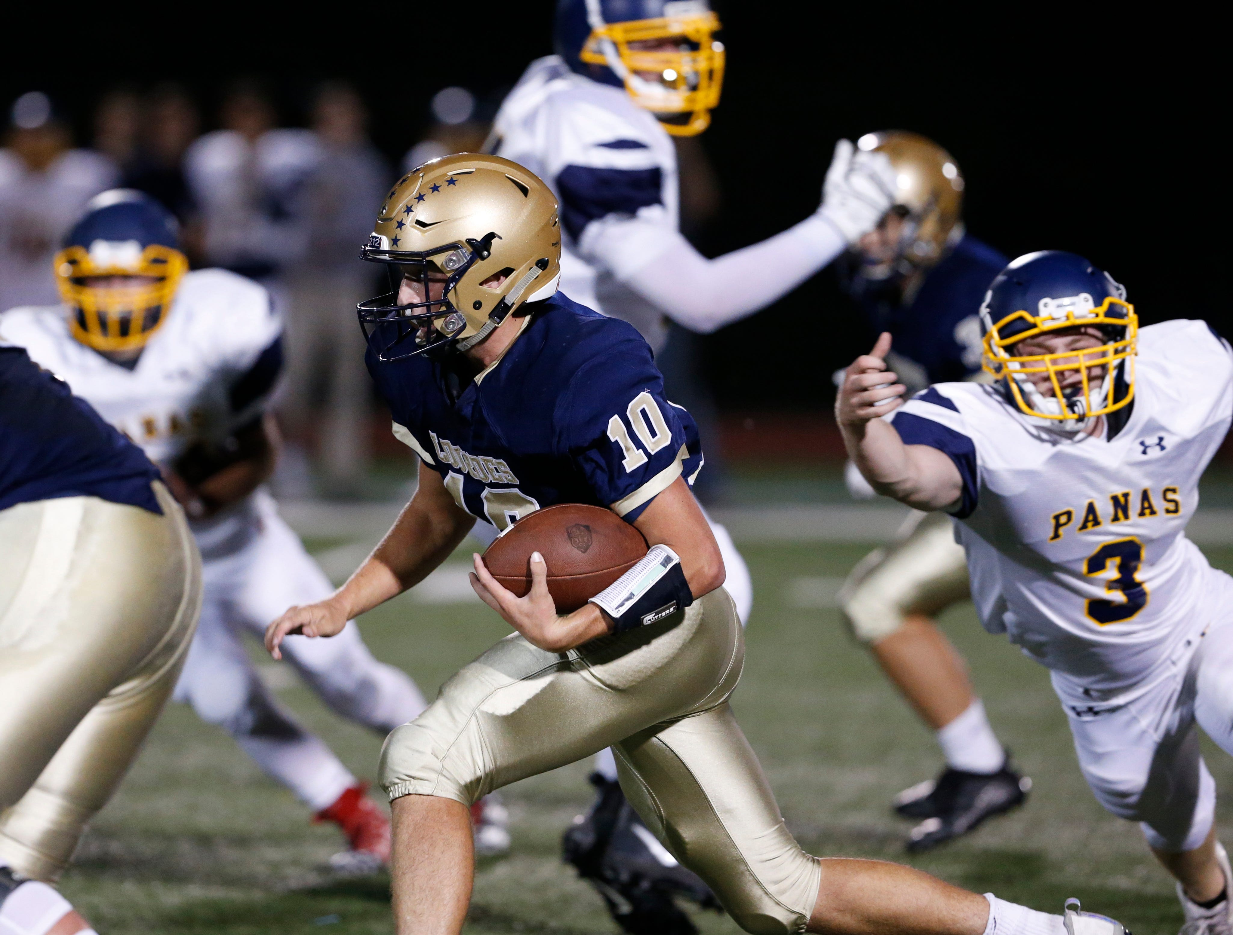 Lourdes' Max Kras narrowly escapes the clutches of Panas' Jack O'Brien during Friday night's game at Lourdes on Sept. 21, 2018.