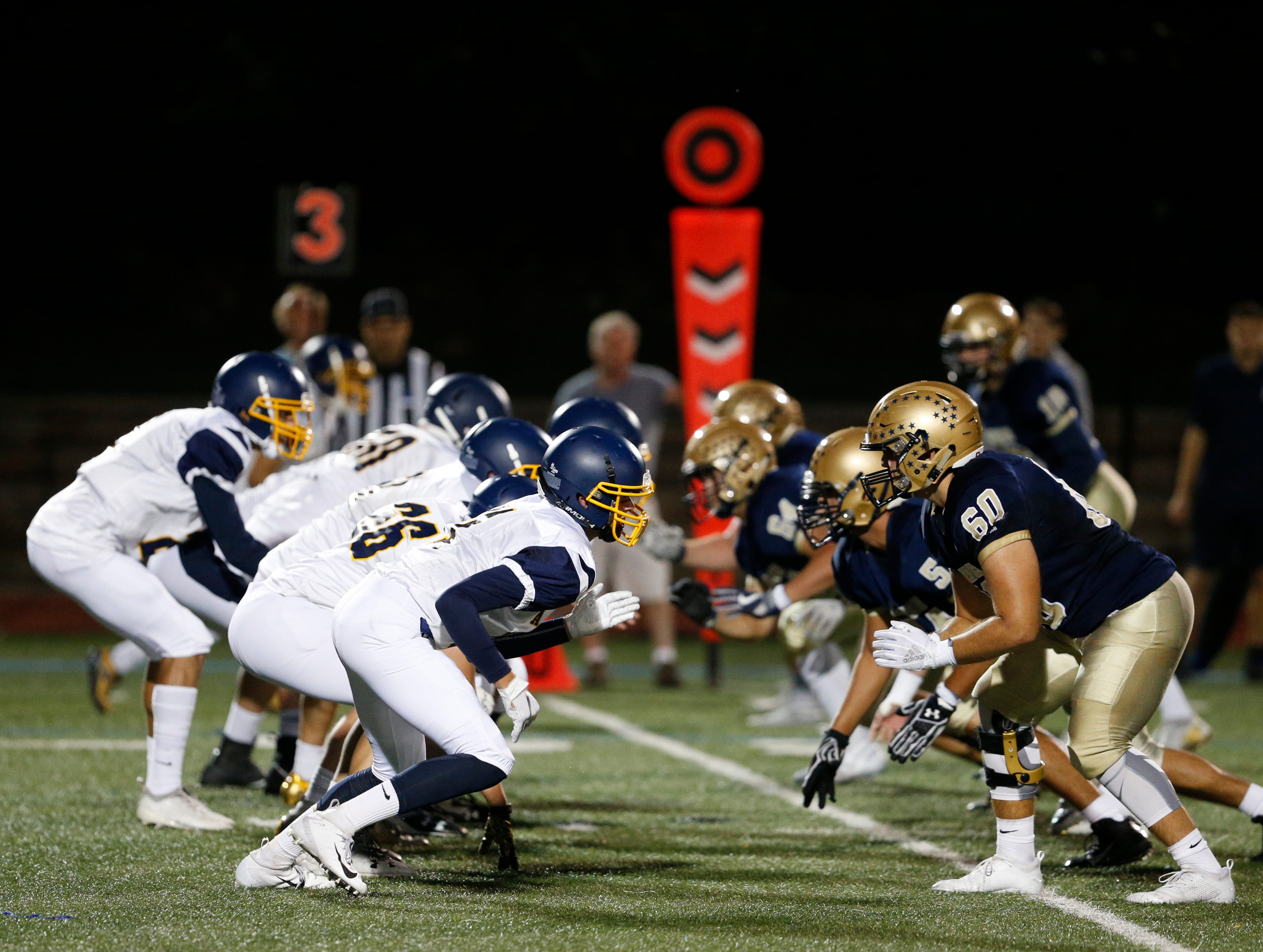 The Walter Panas offensive line sets up across from Lourdes' defensive line before a snap during their Sept. 21 game.
