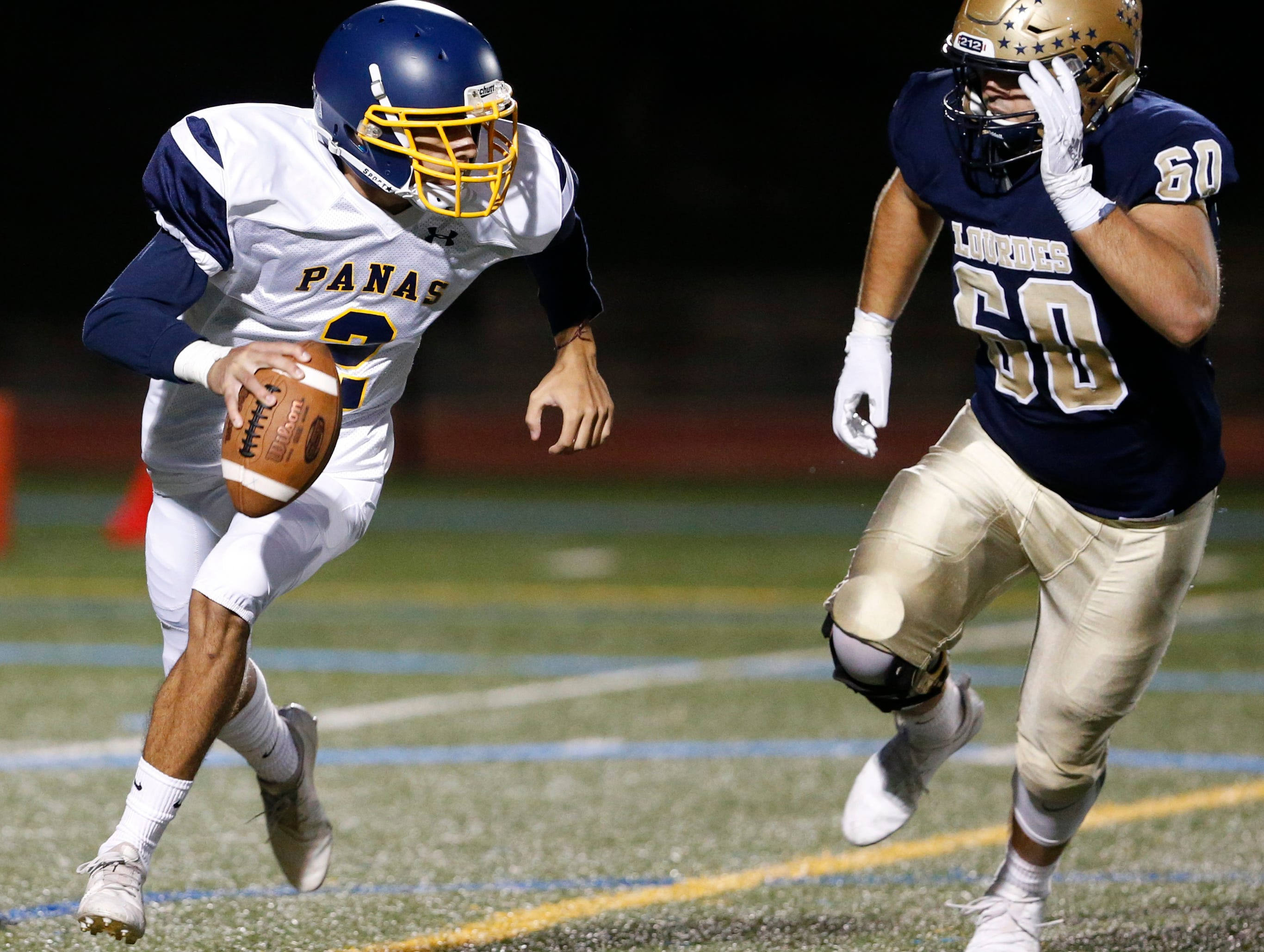 Lourdes' Nick Scalise chases down Panas' Lucas Feliciano during Friday night's game at Lourdes on Sept. 21, 2018.