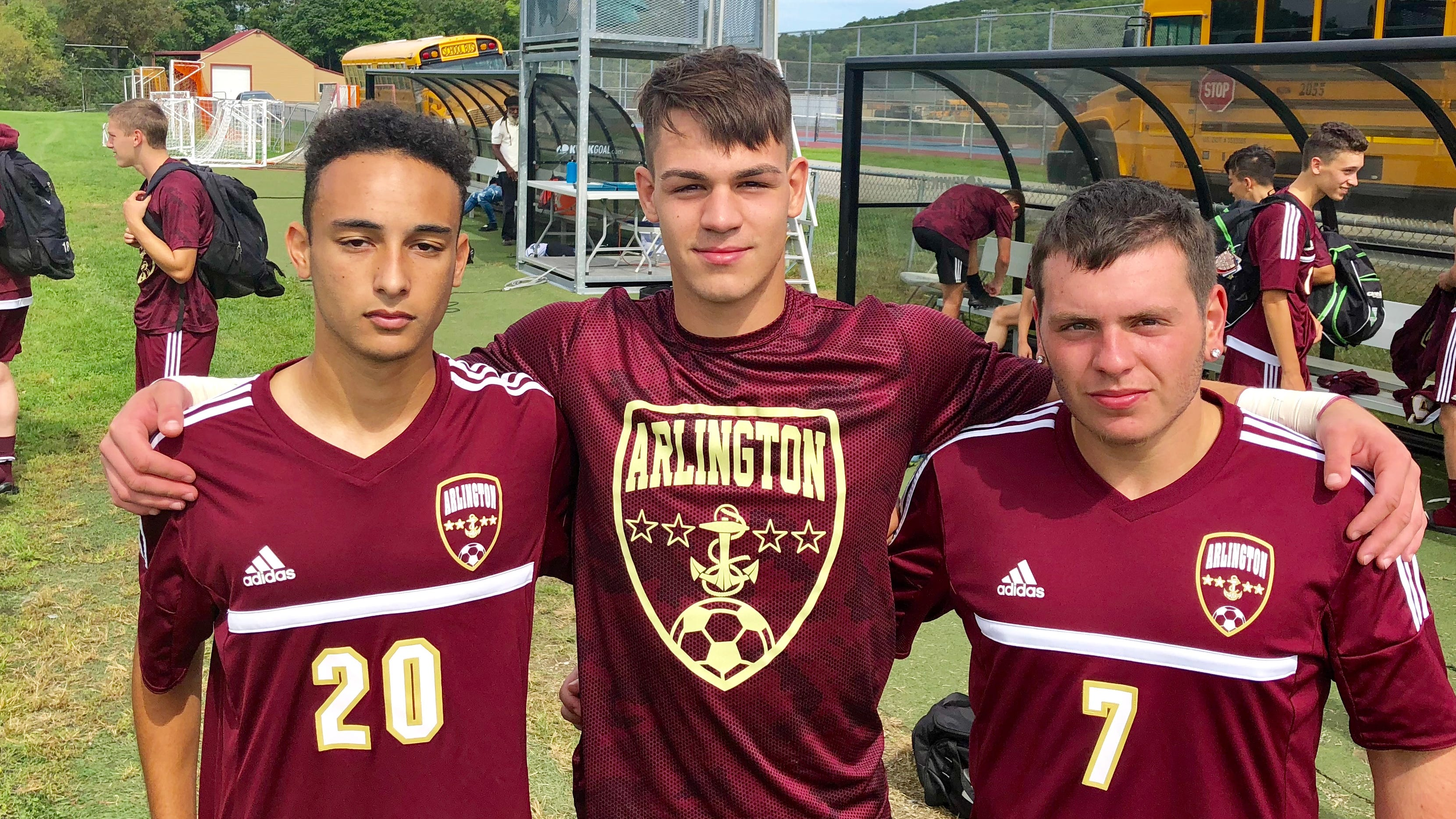 Arlington boys soccer teammates pose for a photo after beating rival Ketcham on Saturday. From left: Nick Espeut, Kevin Klausz and Frankie Colantuono.
