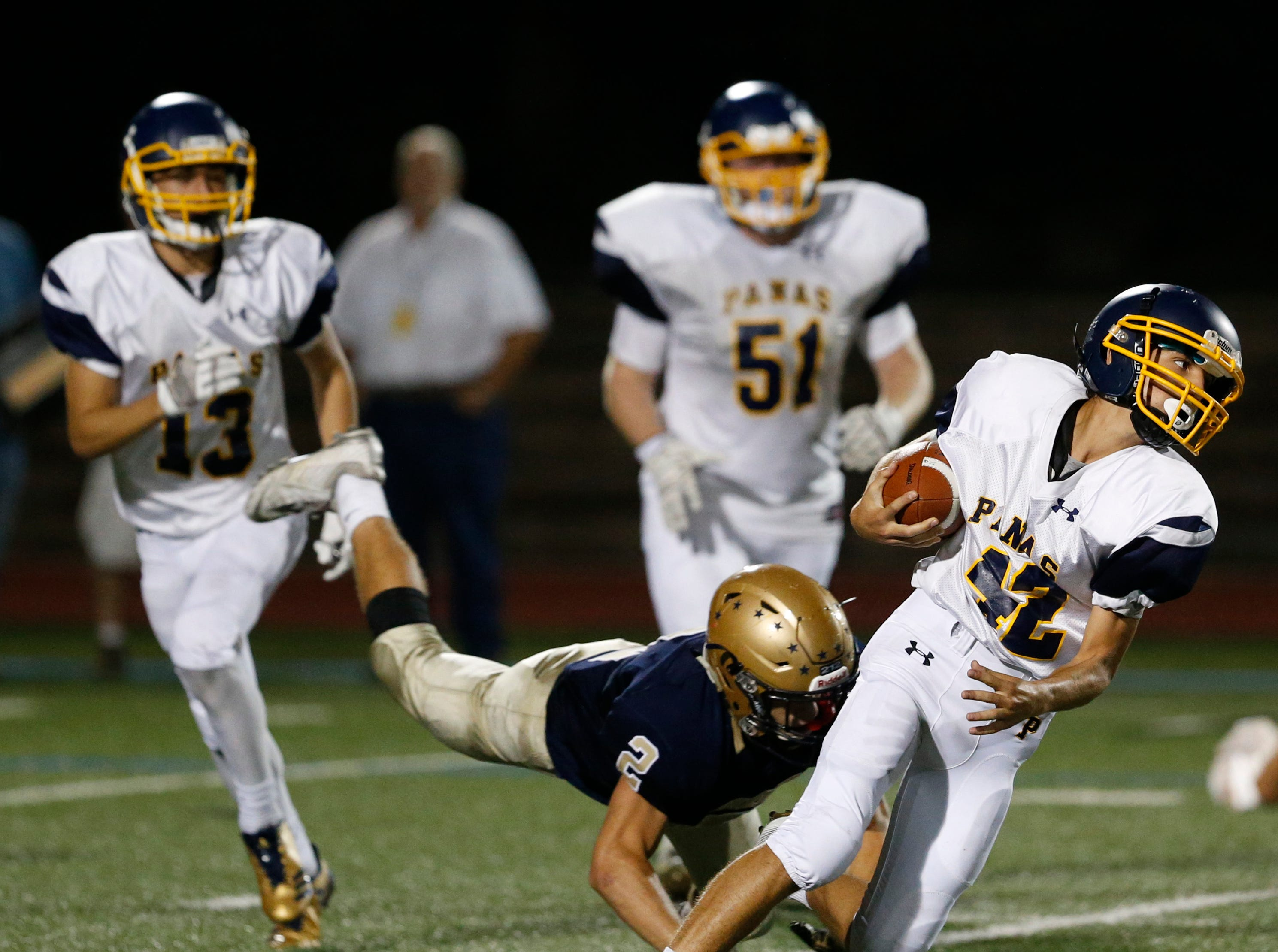 Lourdes' Trevor Arnone dives for and Walter Panas' Derek Pisani during Friday night's game in the Town of Poughkeepsie on Sept. 21, 2018.