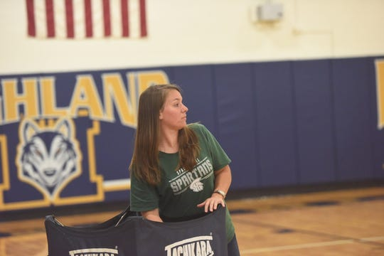 Spackenkill High School volleyball coach Cassi Diamond reaches for a ball as her team conducts warmups before a Sept. 21 match against Highland.