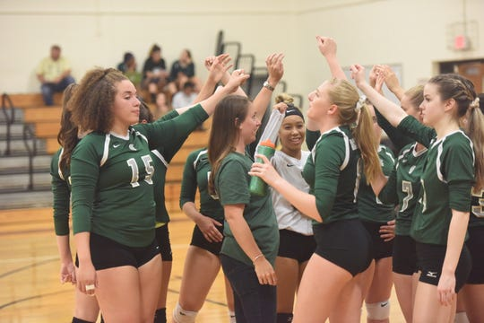 Spackenkill coach Cassi Diamond leads the cheer as the huddle breaks after a timeout during their match Friday against Highland.