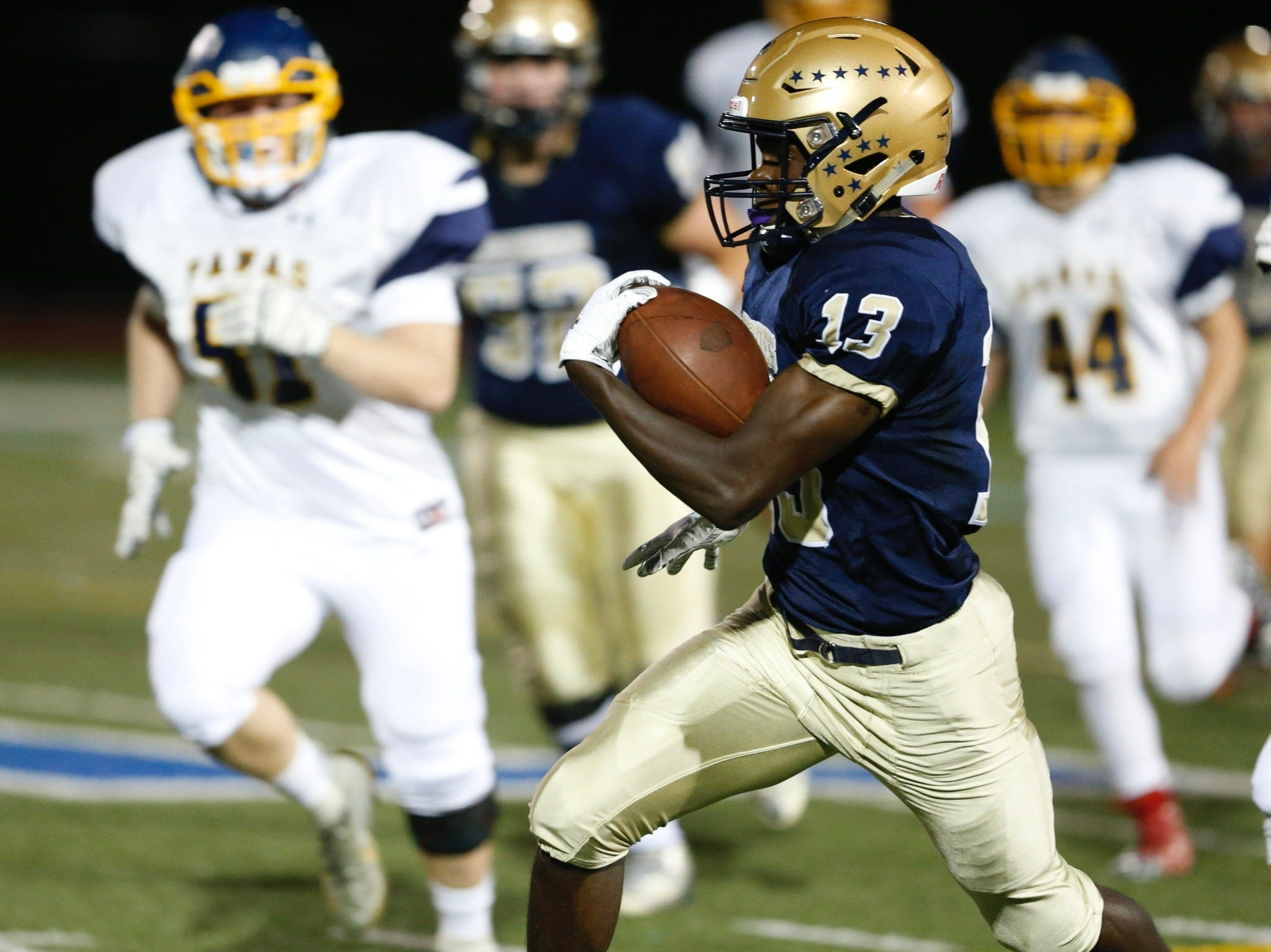 Lourdes' Jaheim Jones carries the ball in the first quarter of Friday's game versus Panas on Sept. 21, 2018.
