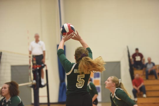 Spackenkill's Bailee Abalos leaps up for a return during their match against Highland on Friday.