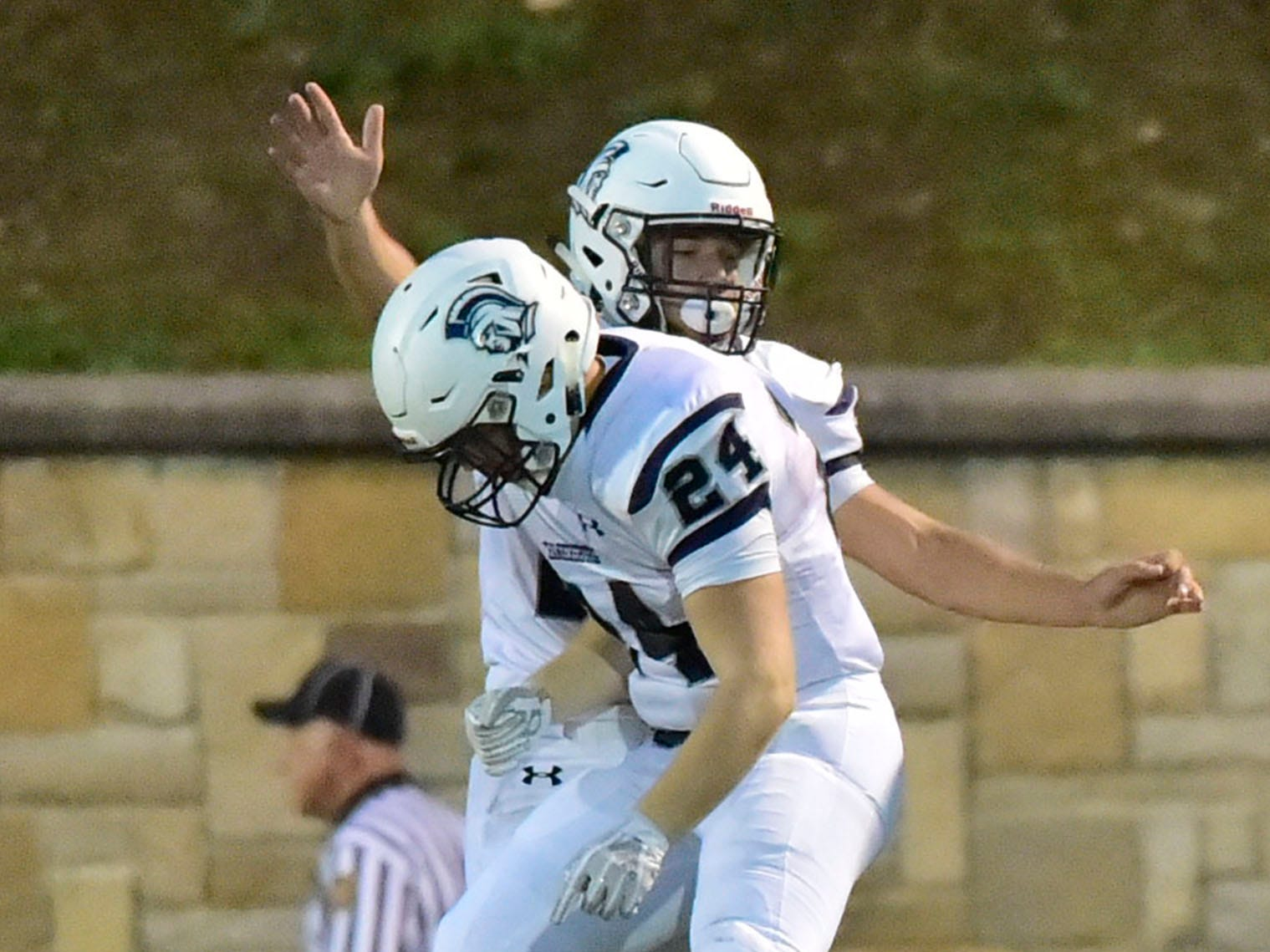 Chamberburg's teammates Kyere Morton and Andrew Shetter (24) celebrate a score. Chambersburg, 4-0 suffered their first loss of the season against undefeated State College in PIAA road game on Friday, Sept. 21, 2018.