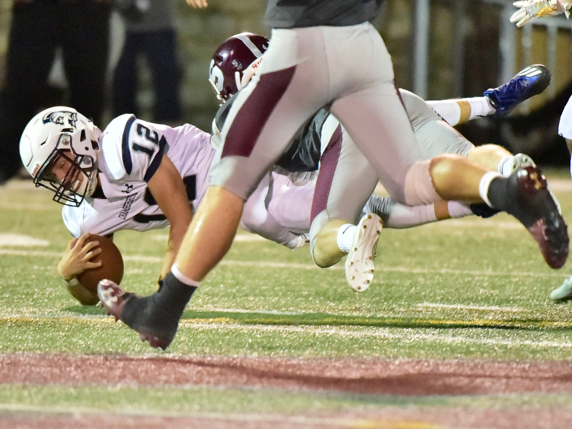 Brady Stumbaugh of Chambersburg is tackled in the forst half. Chambersburg, 4-0 suffered their first loss of the season against undefeated State College in PIAA road game on Friday, Sept. 21, 2018.