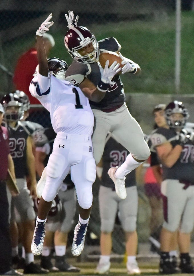 State College's Cohen Russell (2) picks off a pass intended for Kevin Lee, Jr. (1) of Chambersburg. Chambersburg, 4-0 suffered their first loss of the season against undefeated State College in PIAA road game on Friday, Sept. 21, 2018.
