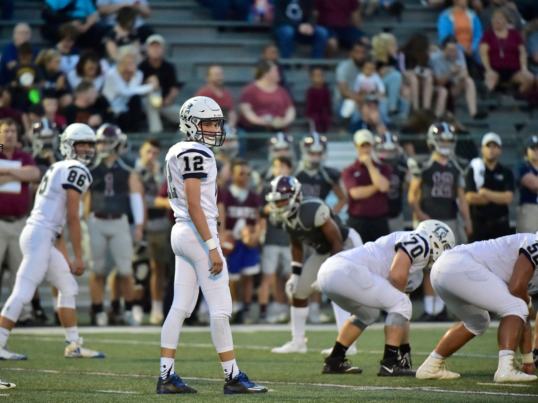 Trojan QB Brady Stumbaugh (12) checks his offense. Chambersburg, 4-0 suffered their first loss of the season against undefeated State College in PIAA road game on Friday, Sept. 21, 2018.