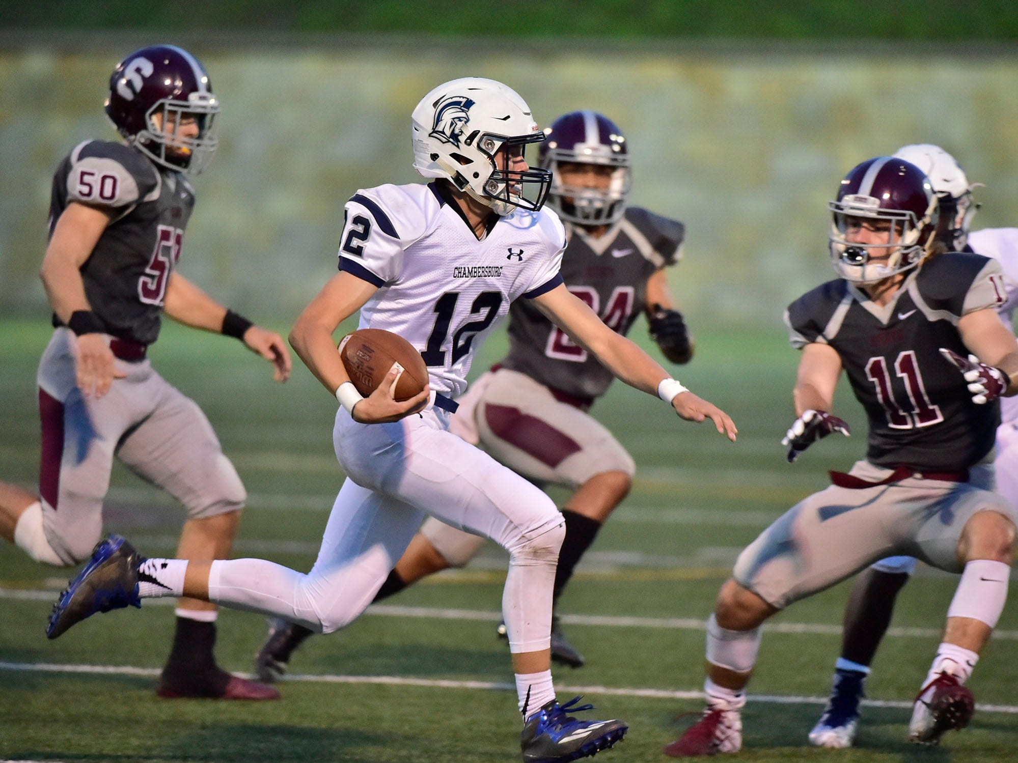 Chambersburg's Brady Stumbaugh picks up a first down. Chambersburg, 4-0 suffered their first loss of the season against undefeated State College in PIAA road game on Friday, Sept. 21, 2018.