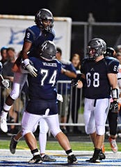 Dallastown's Raymond Christas, front, and Nyzair Smith, back, celebrate a touchdown made by Smith during football action against Northeastern at Dallastown Area High School in York Township, on Friday, Sept. 21, 2018. Dallastown would win the game 41-25. Both Christas and Smith were selected for the Pennsylvania East-West game. Dawn J. Sagert photo