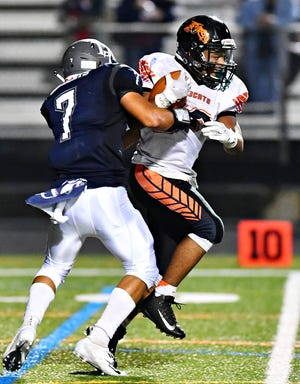 Northeastern running back Manny Capo, shown here carrying the ball against Dallastown in a game earlier this season, ran for three touchdowns in the Bobcats' upset win over Red Lion. DISPATCH FILE PHOTO.