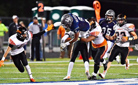 Dallastown's Nyzair Smith, shown here running the ball in a game earlier this season, leads York High's Dayjure Stewart in rushing by five yards. DISPATCH FILE PHOTO