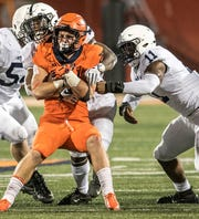 Illinois's Mike Epstein, center, is pinned in the second half of a college football game between Illinois and Penn State, Friday, September 21, 2018, in Champaign, Ill. (AP Photo/Holly Hart)