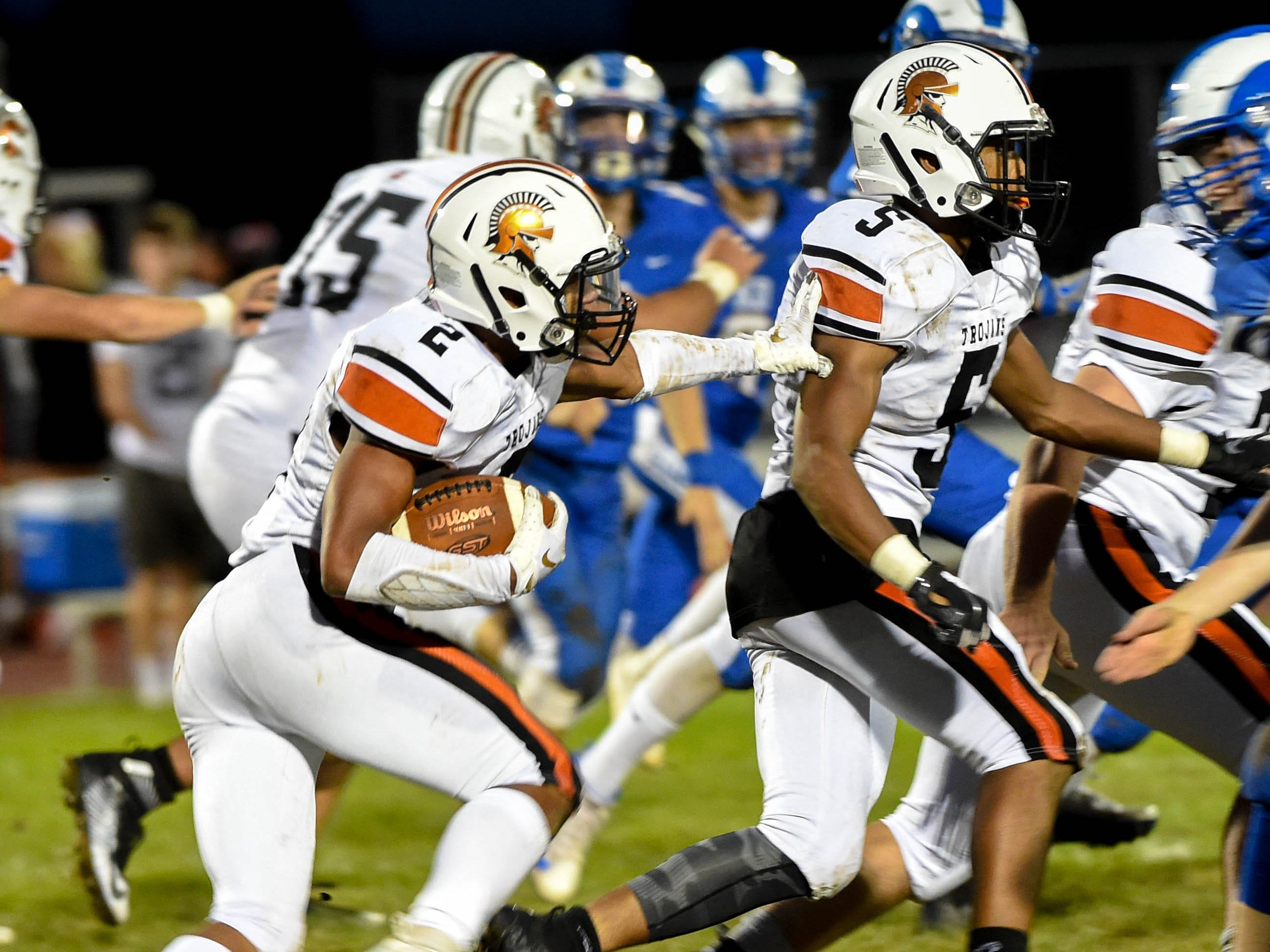 Savion Harrison (2) uses his blocker during the game between Kennard-Dale and York Suburban, Friday, September 21, 2018. The York Suburban Trojans beat the Kennard-Dale Rams 31-25.