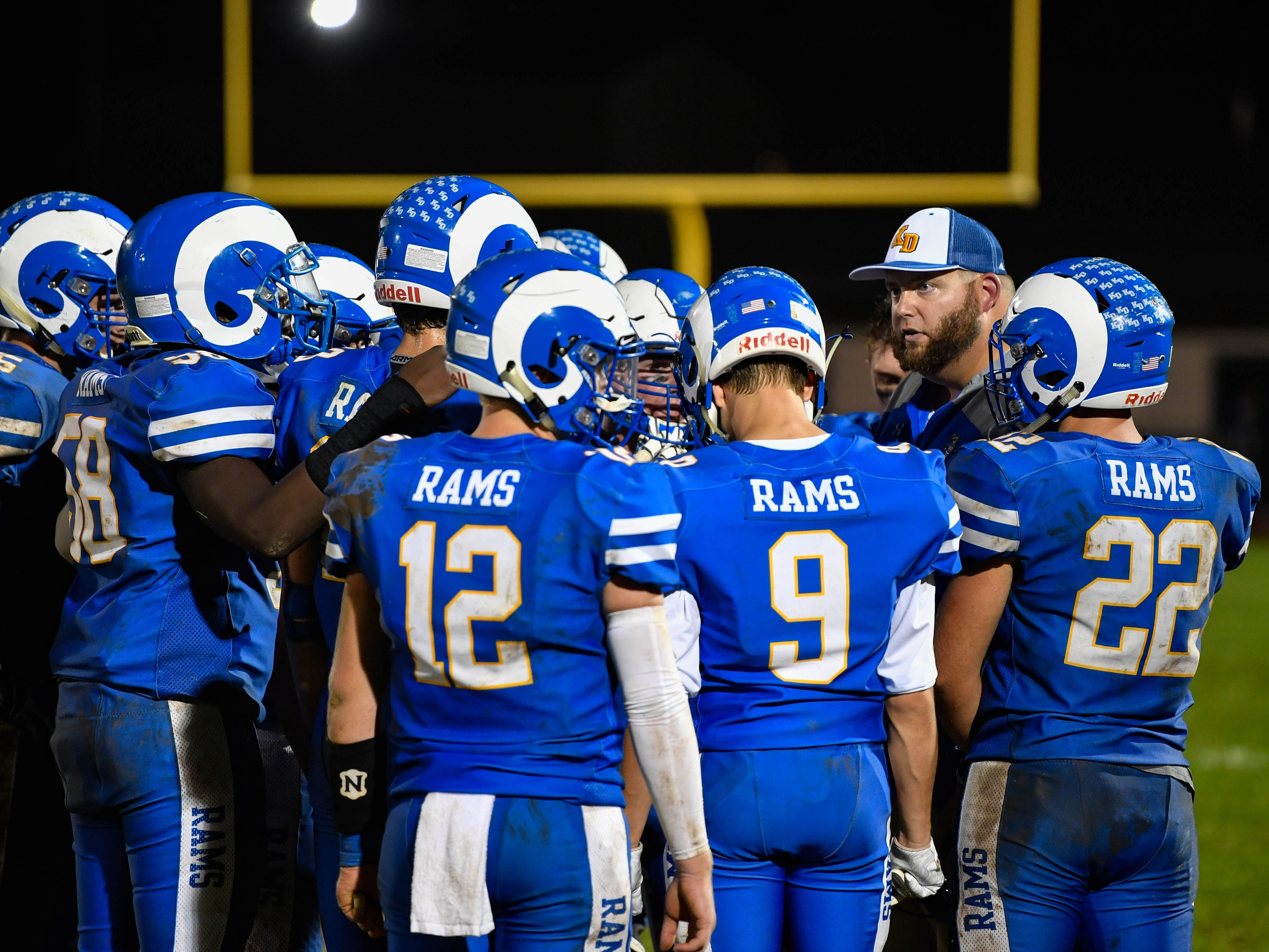 Kennard-Dale huddles up to figure out their next play  Friday, September 21, 2018. The York Suburban Trojans beat the Kennard-Dale Rams 31-25.