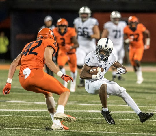 Penn State wide receiver KJ Hamler (1) tries to avoid Illinois's Michael Marchese (42) during the first half of an NCAA college football game Friday, Sept. 21, 2018, in Champaign, Ill. (AP Photo/Holly Hart)