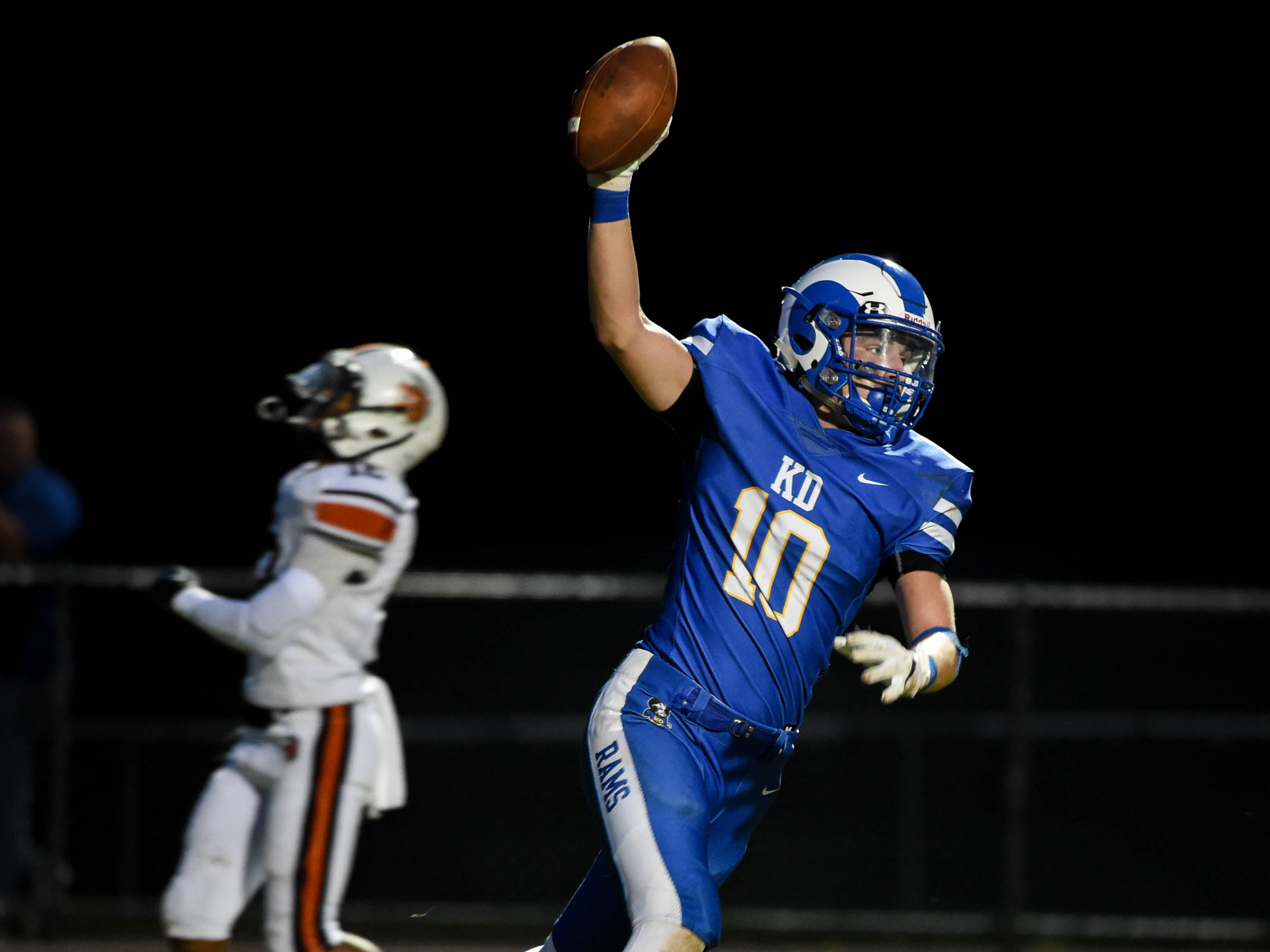Garrett Love (10) of Kennard-Dale proudly raises the ball after scoring a touchdown, Friday, September 21, 2018. The York Suburban Trojans beat the Kennard-Dale Rams 31-25.