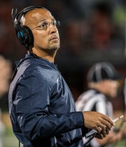 Penn State coach James Franklin stands along the sideline during the second half of the team's NCAA college football game against Illinois on Friday, Sept. 21, 2018, in Champaign, Ill. (AP Photo/Holly Hart)