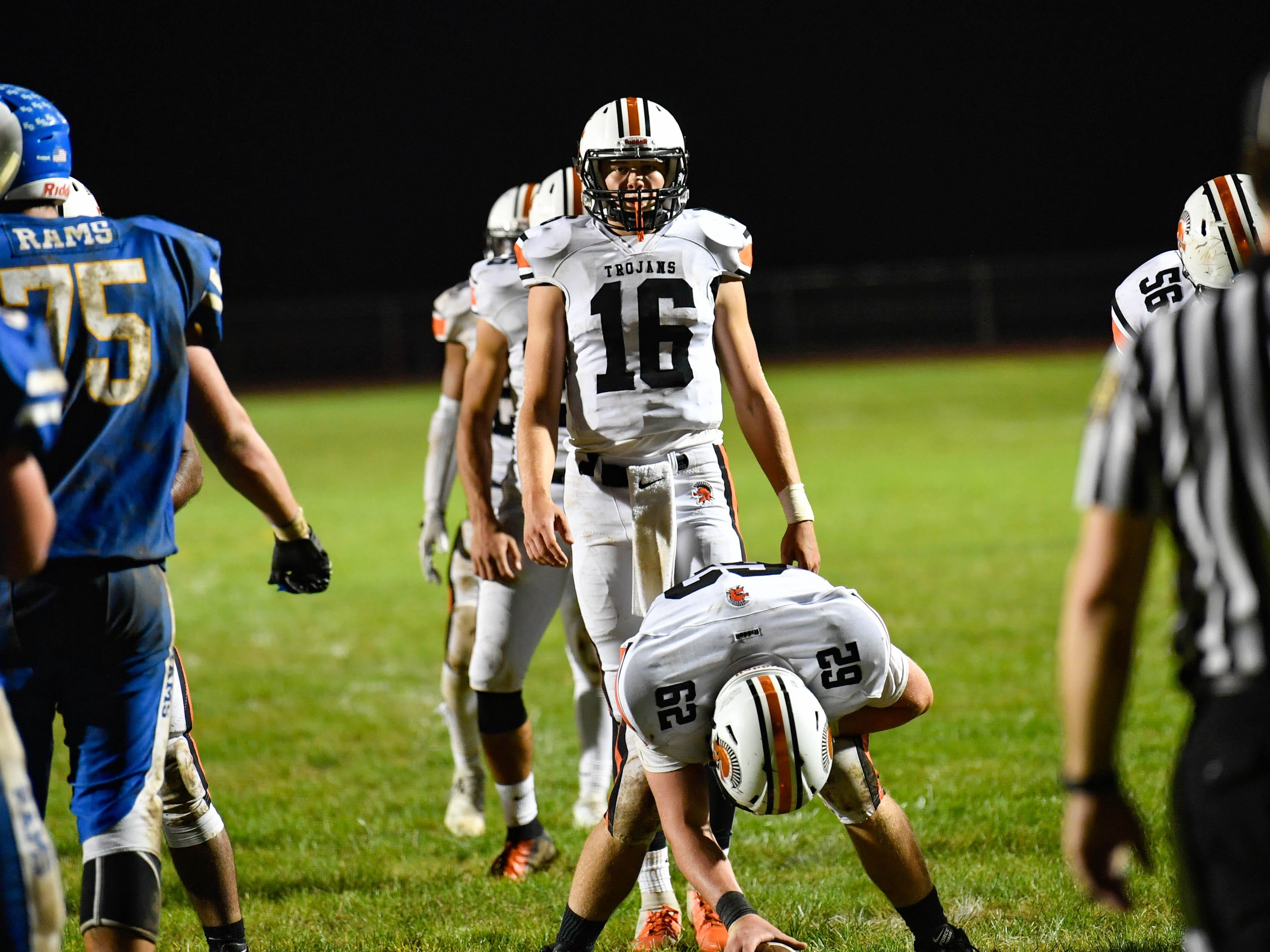 Max Reinecker (16) analyzes the defense before snapping the ball, Friday, September 21, 2018. The York Suburban Trojans beat the Kennard-Dale Rams 31-25.