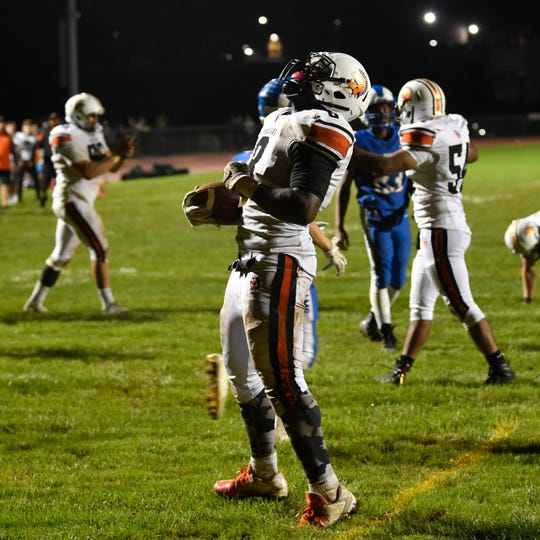 Keyvon Wright (8) celebrates his touchdown during the Division II football game between Kennard-Dale and York Suburban, Friday, September 21, 2018. The York Suburban Trojans beat the Kennard-Dale Rams 31-25.