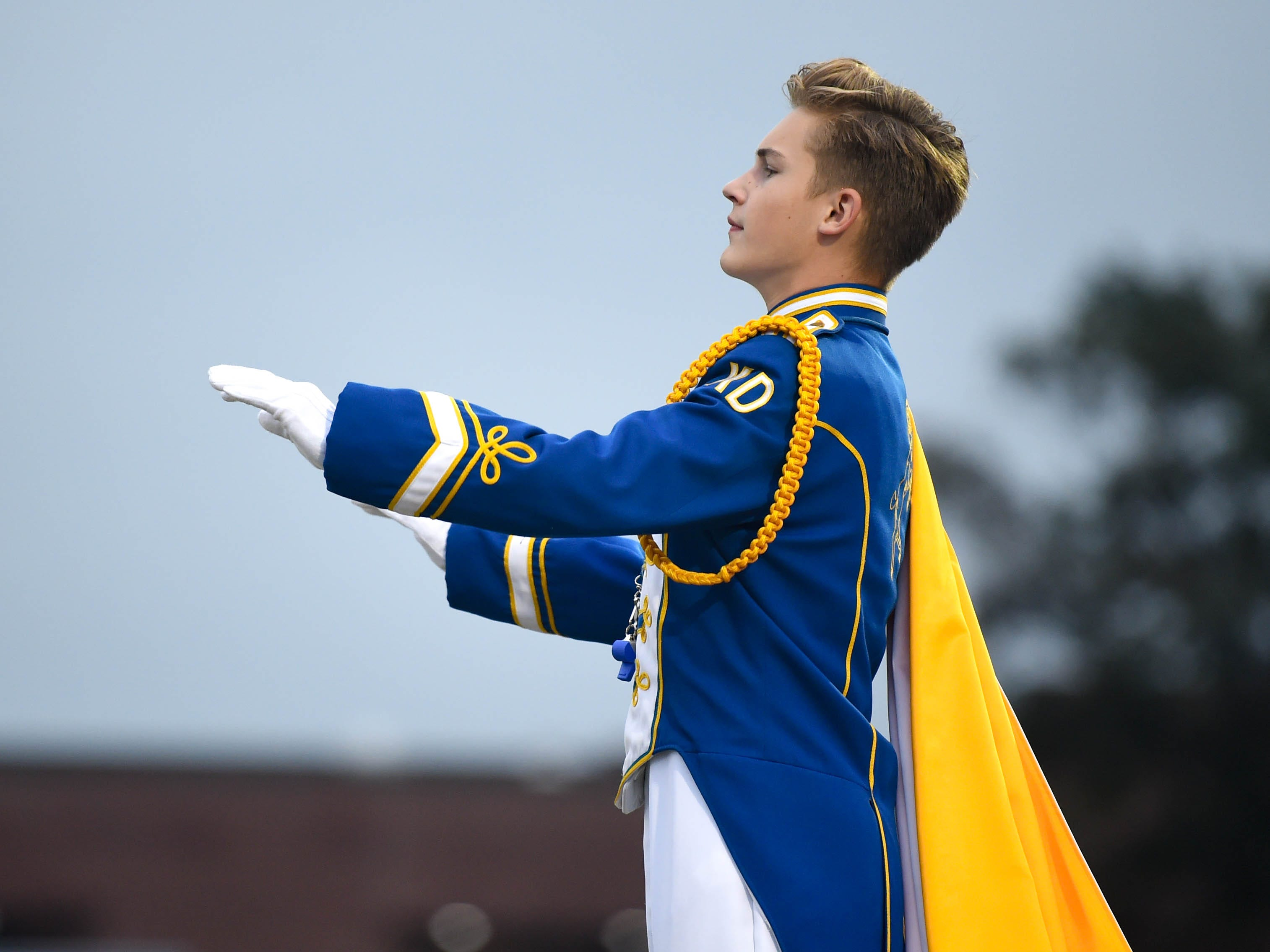 Kennard-Dale's conductor guides the band, Friday, September 21, 2018. The York Suburban Trojans beat the Kennard-Dale Rams 31-25.