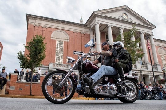 Bikers make their way down East Market St. for the York Bike Night parade on Saturday, September 22, 2018. The 24th annual York Bike Night was held in downtown York, offering live music, food, an assortment of vendors and hundreds of motorcycles to admire.