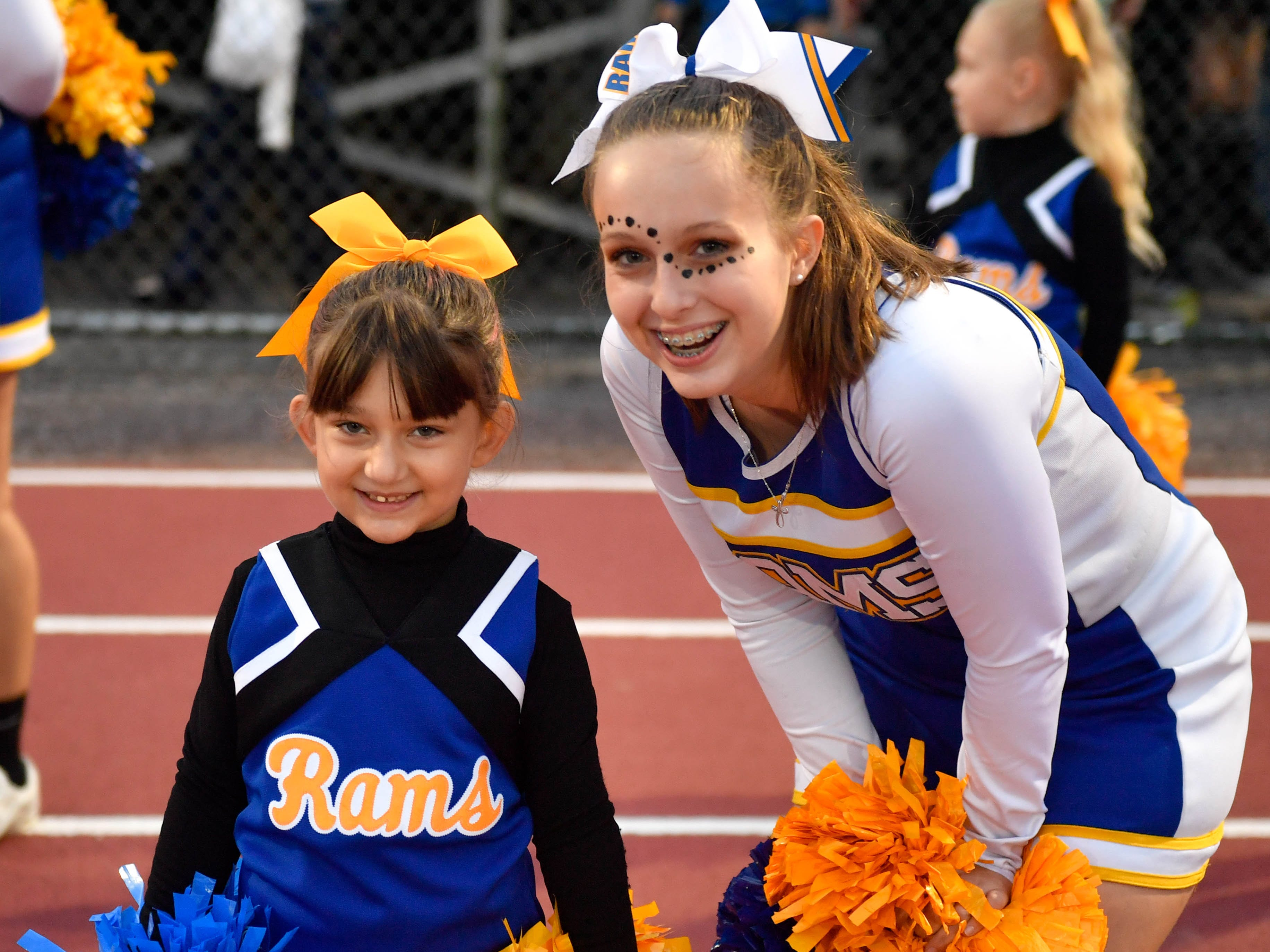 Youth cheerleaders joined high school cheerleaders in hyping up the crowd during the Division II football game between Kennard-Dale and York Suburban, Friday, September 21, 2018. The York Suburban Trojans beat the Kennard-Dale Rams 31-25.