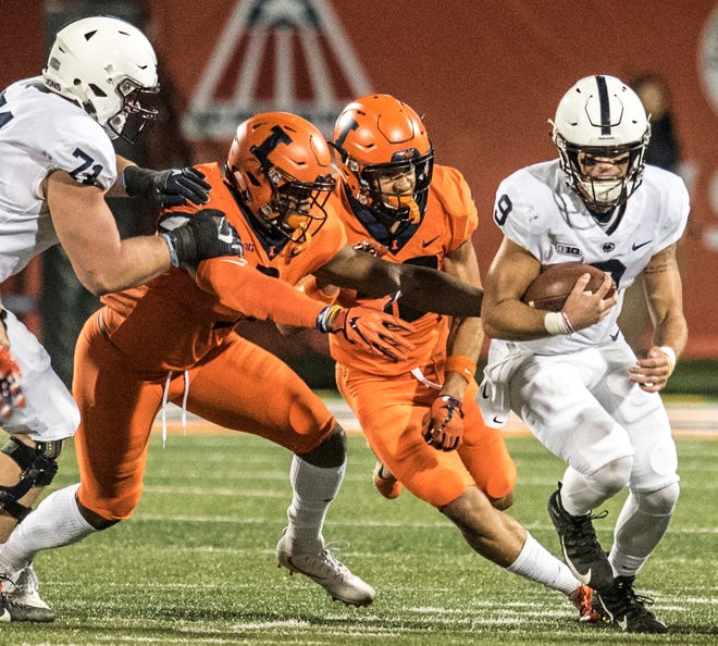 Penn State quarterback Trace McSorley (9) avoids the Illinois defense during the first half of an NCAA college football game Friday, Sept. 21, 2018, in Champaign, Ill. (AP Photo/Holly Hart)
